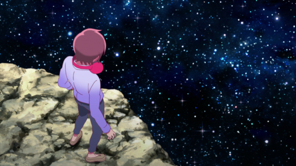 A boy wearing headphones around his neck stands at the edge of a cliff overlooking a sea of stars