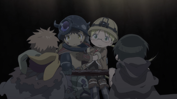 A boy wearing a metal helmet with horns and a girl wearing a miner's helmet and hiking gear hold onto each other and smile at two other figures with short hair who're facing away from the camera. They appear to be in some kind of mine.