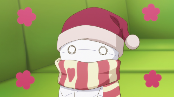 A tiny mummy wearing a striped scarf and a Santa hat, with flowers bursting around him