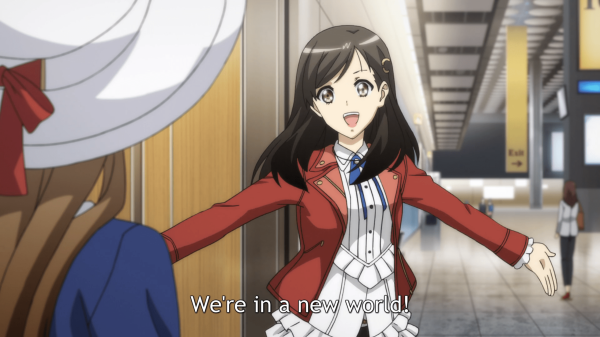 "A young woman in a red jacket spreads her arms, smiling, and says ""We're in a new world!"""