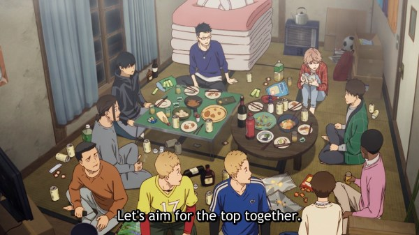 "A group of young men sit around a low table in a messy, Japanese-style living space, drinking and eating. One says ""Let's aim for the top together!"""