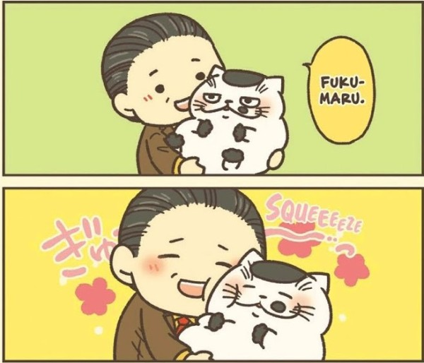 "A two-panel comic of a man holding a cat. He says ""Fukumaru"" in the top panel and then presses his cheek to the cat's cheek. Sound effects read ""Squeeze."" They both look delighted."